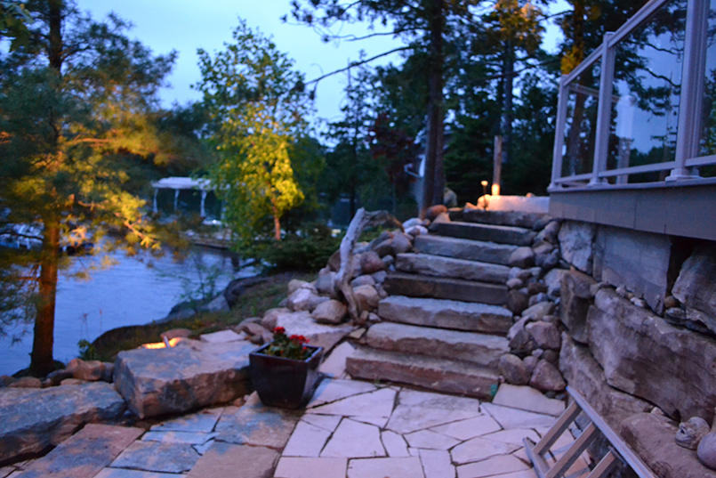 lakeside path and steps in stone with lighting